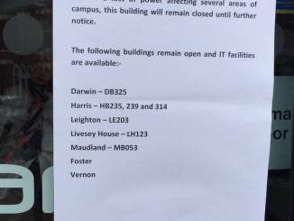 A notice on the library entrance informing students about the situation