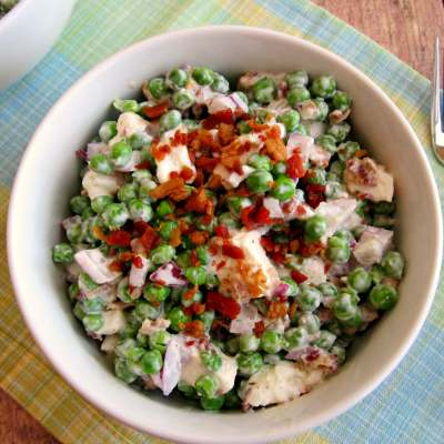 Filled with crunchy peas, feta cheese, red onion, and crumbled bacon, this Creamy Pea Salad will take your salad experience to a whole new level!