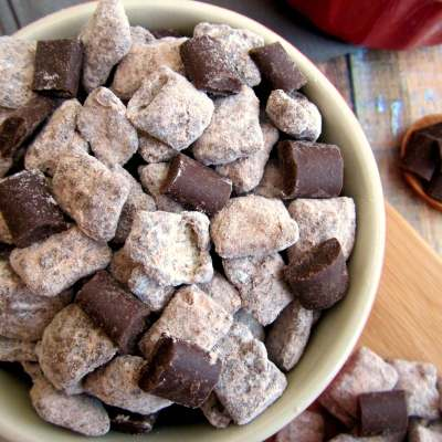 Chocolate Chex Mix cereal coated with red velvet cake mix, melted milk chocolate, chocolate chunks, and powdered sugar will wow your tastes buds with this Red Velvet Muddy Buddies treat.