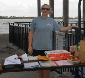 Shana signing volunteers in