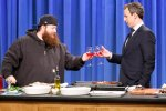 LATE NIGHT WITH SETH MEYERS -- Episode 354 -- Pictured: (l-r) Rapper/chef Action Bronson during a cooking segment with host Seth Meyers on April 11, 2016 -- (Photo by: Lloyd Bishop/NBC)
