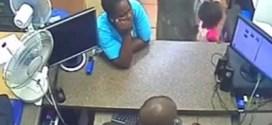 فيديو : امرأه نيجيريه تستخدم طفله في سرقة هاتفين من محل تجاري !!