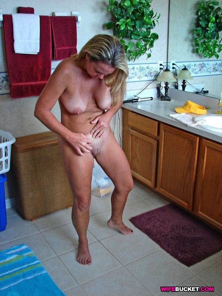 mature naked in shower