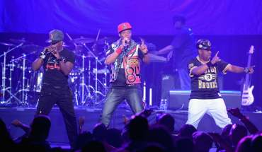 LOS ANGELES, CA - JUNE 25:  (L-R) Singers Ricky Bell, Ronnie DeVoe and Michael Bivins of Bell Biv DeVoe perform onstage at the Bell Biv Devoe with Doug E. Fresh concert during the 2015 BET Experience at Club Nokia on June 25, 2015 in Los Angeles, California.  (Photo by Jason Kempin/BET/Getty Images for BET)