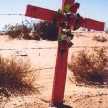 Pink crosses mark the site where women's bodies were found in the dusty ground of a hill overlooking a shantytown in Juarez.    Credit: Kari Lydersen via Carnegie Council