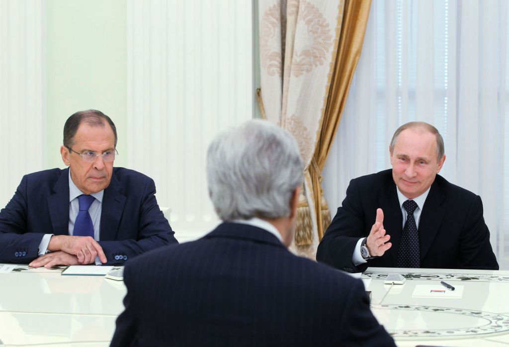 Russia's President Vladimir Putin (R) and Foreign Minister Sergei Lavrov (L) hold talks with US Secretary of State John Kerry (C) in the Kremlin in Moscow, on May 7, 2013. Kerry sought today to narrow differences over the conflict in Syria with Putin, urging the Russian strongman to find common ground to help end the bloodshed. AFP PHOTO/ RIA-NOVOSTI/ POOL / MIKHAIL KLIMENTYEV (Photo credit should read MIKHAIL KLIMENTYEV/AFP/Getty Images)