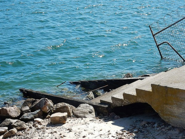 broken steps into water