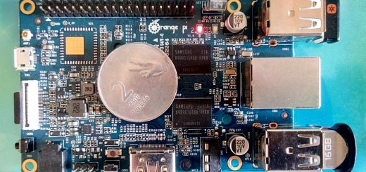 Orange Pi Mini 2 Board with a coin for heat-sink