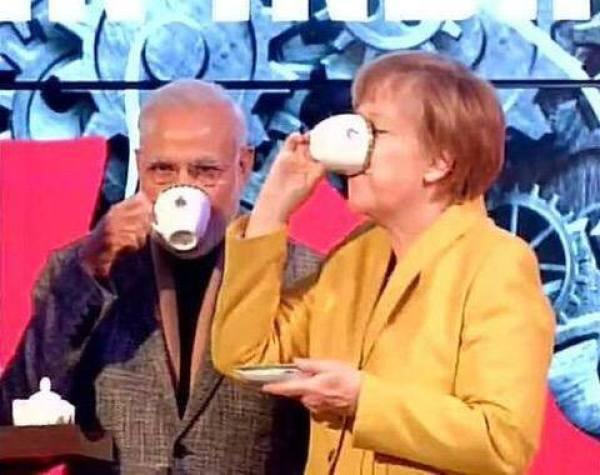 1429014232-459_Modi-Merkel