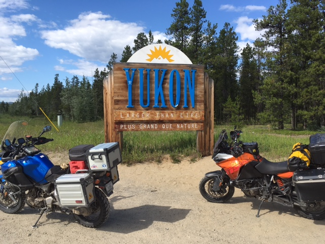 Our bikes at the Welcome to Yukon sign.
