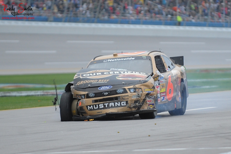 May 4, 2013; Talladega, AL, USA; NASCAR Nationwide Series driver Trevor Bayne (6) enters pit lane after crashing during the Aaron's 312 at Talladega Superspeedway. Regan Smith won the race. Mandatory Credit: Randy Sartin-USA TODAY Sports