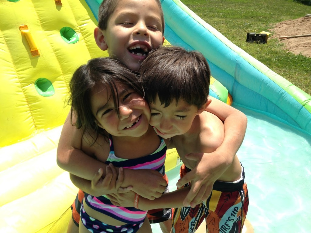 Ellie, Isaac, and Joel (The water slide is gone, so now we have a POOL!)