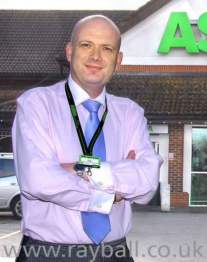 Outdoor portrait of the new manager at Asda, Burgh Heath, Surrey. ASr_0434ck