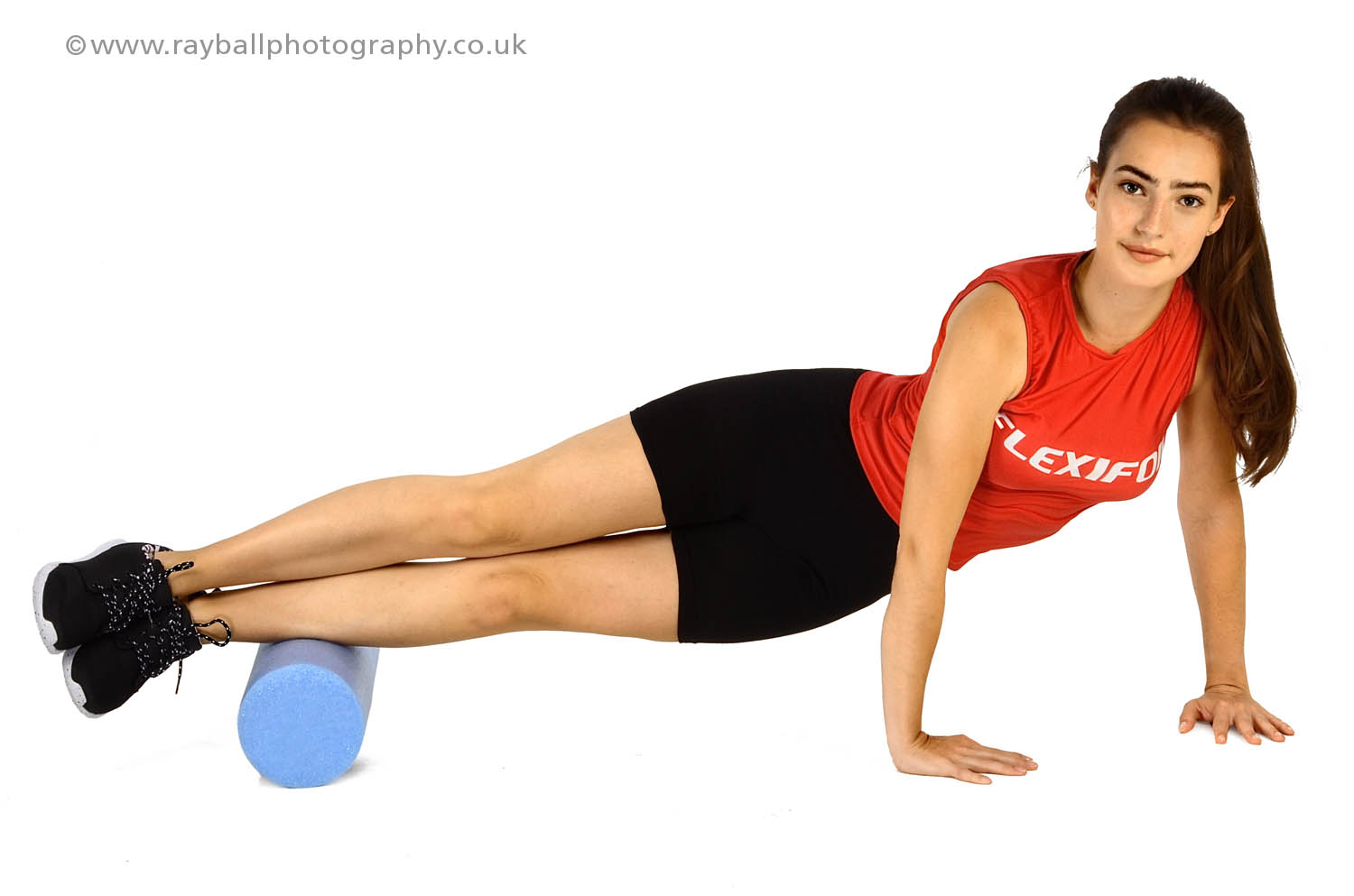 Flexifoil - power kite manufacturer for land and kitesurfing with headquarters in Chessington - Limber up with a Flexifoil foam roller - picture demonstrates toning the peroneal muscles.