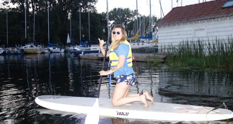 Raymi the Minx is paddleboarding with Toronto Island SUP