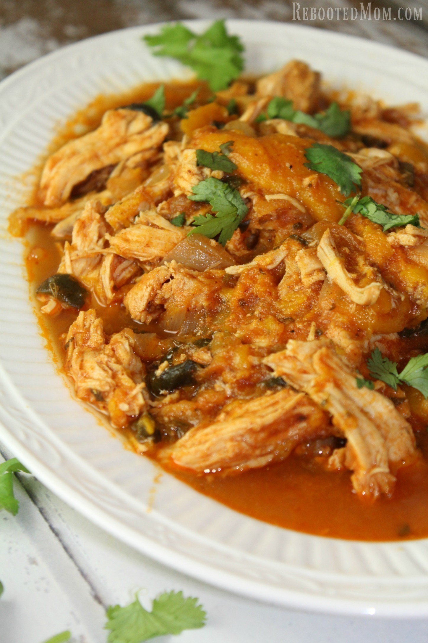 This Mango Lime Pulled Chicken is a one pot meal of shredded chicken that bathes in a fiery sauce of mangoes, tomatoes, and spices that's wonderful served over rice.