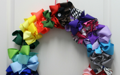 This DIY Hair Bow Wreath is the perfect solution to help organize a TON of hair bows!  It takes a few dollars and less than 5 minutes to put together.
