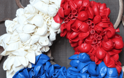 This DIY Patriotic Balloon Wreath is SUPER cute and perfect for July 4th, Labor Day or even Memorial Day!  It's a fun and easy craft that the kids can help you accomplish.