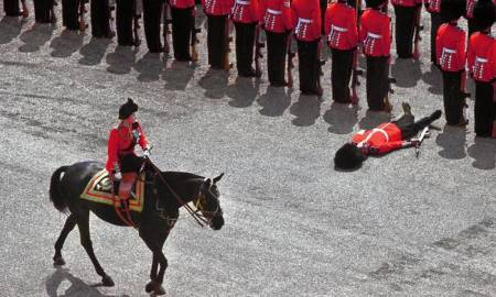 The Queen of Canada reviews her troops. She's wearing a Busby; he's in a bearskin.