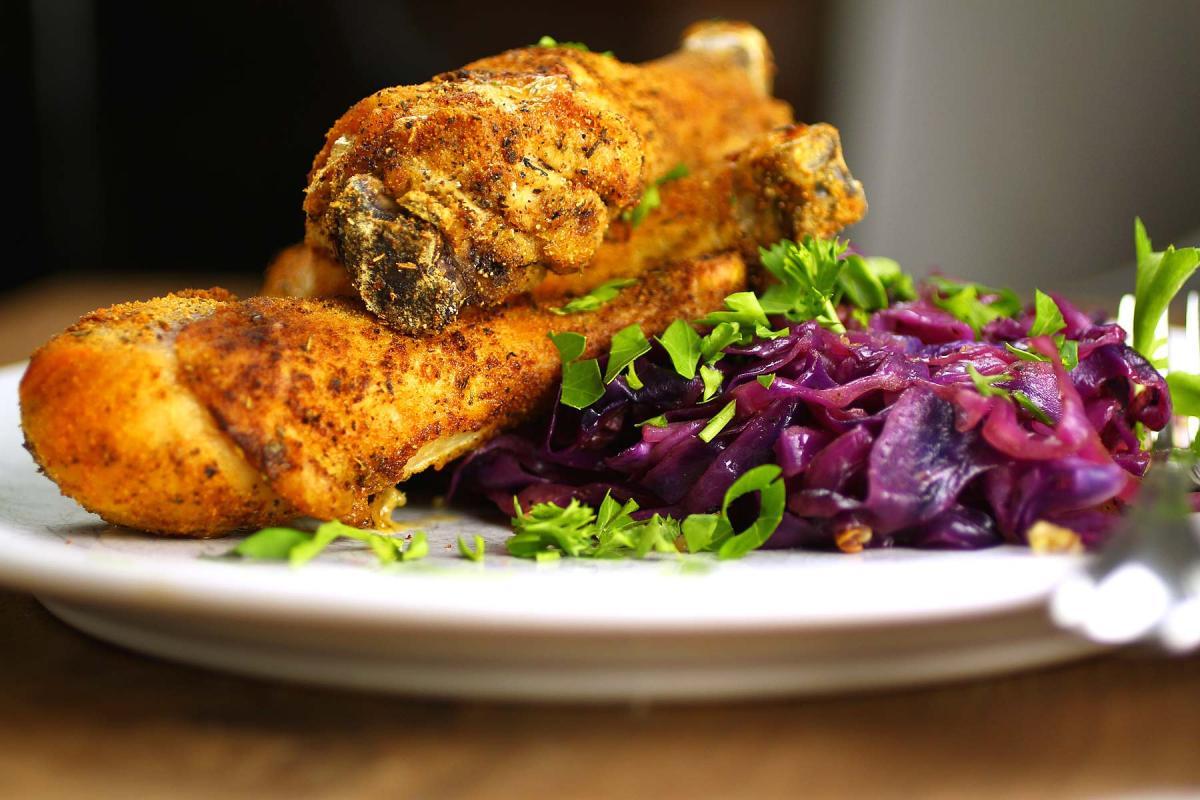 paleo baked chicken drumsticks and braised red cabbage