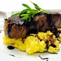 Seared Steak over Soft Polenta w/ a Fig Balsamic Reduction