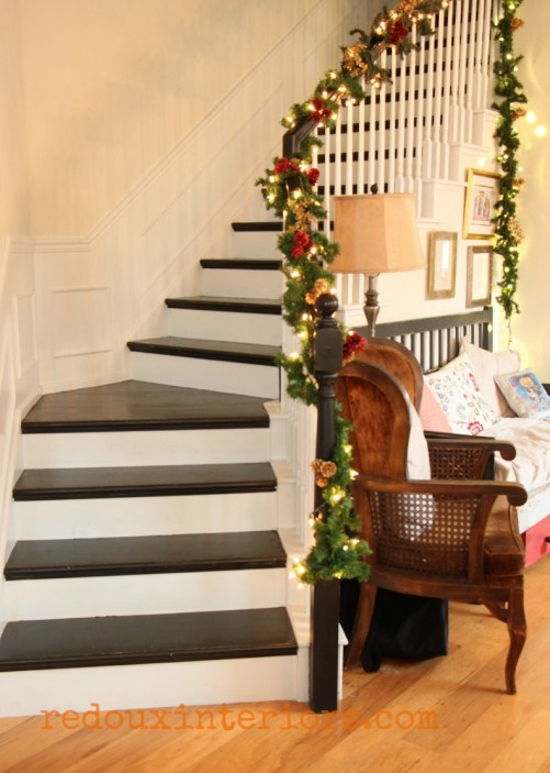 Redouxinteriors Holiday Home Tour garland on black and white stairs