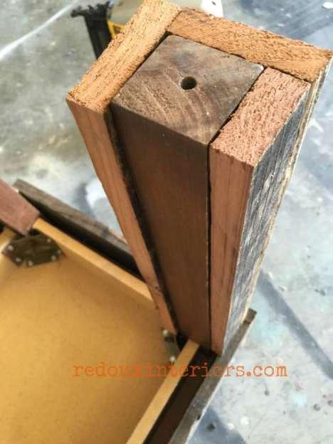 Junk Table with Barn wood overlay leg redouxinteriors
