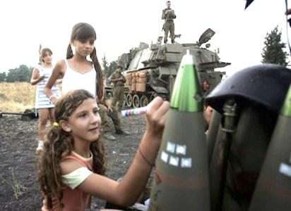 Israeli girl writes on a bomb
