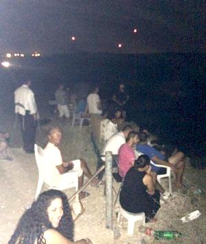 Israelis bring chairs to a hilltop in Sderot, on the border with Gaza, to watch their air force strike Palestinian civilians, clapping and cheering when they hear the bomb blasts