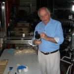 Jim Sr. hand numbering bottles