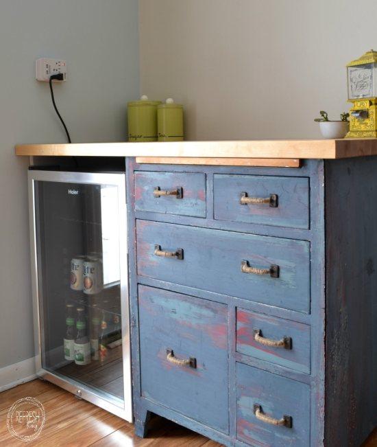 custom beverage center with mini fridge and antique dresser
