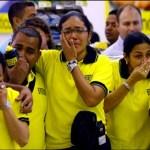 """(Foto Archivo) Trabajadores de Almacenes Éxito en Venezuela, durante la """"diligencia"""" de expropiación."""