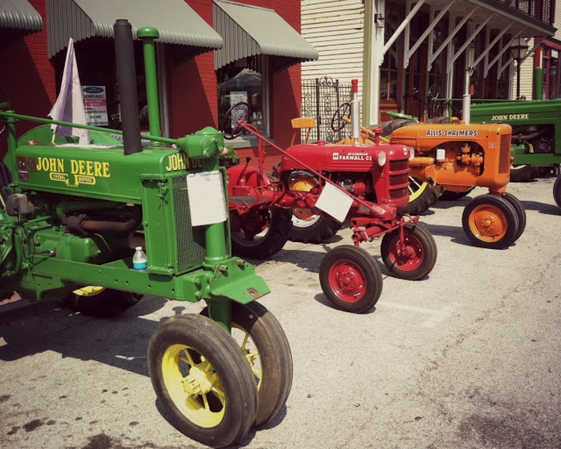 Bright colors at an atique tractor show. Via This Mare Eats Oats Blog.