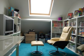 Another view of the gaming chair, showing the great light we get from that big Velux roof window.