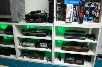 Top: Sega MD and MCD, PS2, 1st row: ColecoVison, Atari 7800, 2nd row: SNES, GameCube, Intellivision, Bottom row: N64, Channel F