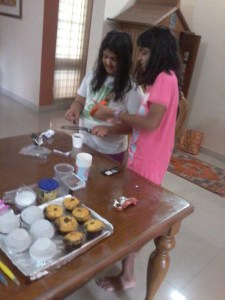 Packing the cup cakes - vanilla, chocolate and marble!