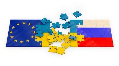 puzzles of stacked flags European Union, Russia and Ukraine