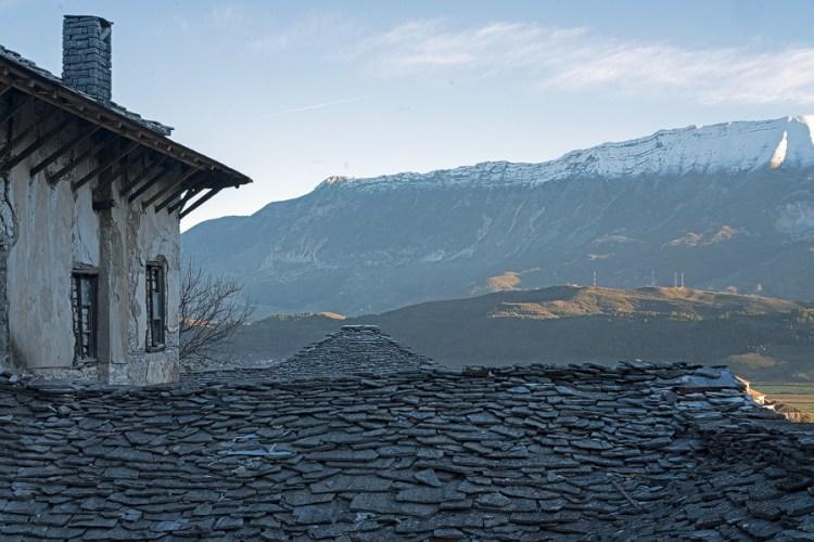 The steep, stone-tiled roofs of Gjirokaster.