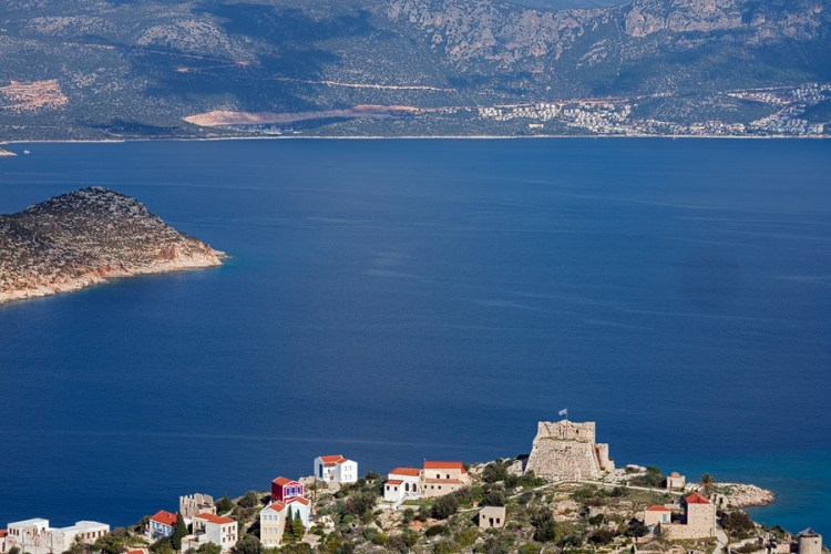 Kaş viewed from Kastellorizo, with the castle of the Knights of St John standing watch.
