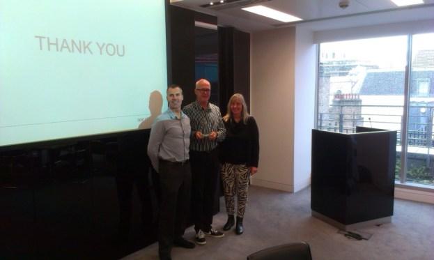 NNE Pharmaplan receive their gold award from Sam Marshall