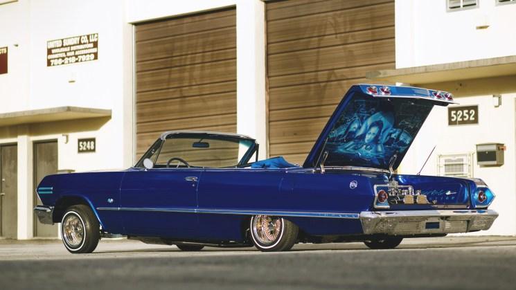 rides magazine chevy chevrolet impala lowrider wire wheels blue wave bowtie connection florida small block jl audio hydraulics custom car