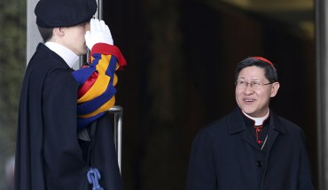 (RNS1-may14) Cardinal Luis Antonio Tagle, right, leaves during a consistory led by Pope Francis at the Vatican on February 12, 2015. Photo courtesy of REUTERS/Alessandro Bianchi  *Editors: This photo may only be republished with RNS-TAGLE-CARITAS, originally transmitted on May 15, 2015.