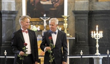 Stig Ellins (L) and his partner Steen Andersen pose with a rose after their wedding at Frederiksberg church in Copenhagen on June 15, 2012. Denmark, a pioneer in gay rights, on Thursday saw its parliament vote overwhelmingly in favour of allowing homosexuals to marry in the state Evangelical Lutheran Church. The bill presented by Denmark's centre-left government earlier this year passed with 85 votes in favour and 24 opposed, with two abstaining and the rest of the 179-seat house absent.   Denmark was the first country in the world to allow gay couples to enter into civil unions in 1989, and homosexuals have since been given the right to receive a church blessing for their unions, but Thursday's vote sealed their right to have a full marriage ceremony in church. AFP PHOTO / SCANPIX DENMARK - LISELOTTE SABROE