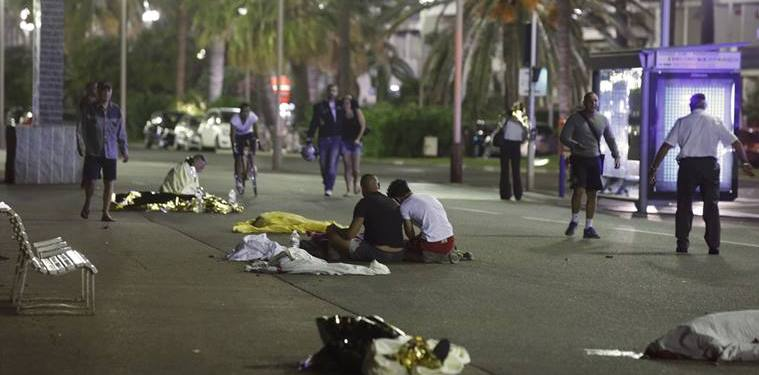 ATTENTION EDITORS - VISUAL COVERAGE OF SCENES OF INJURY OR DEATH - Bodies are seen on the ground July 15, 2016 after at least 30 people were killed in Nice, France, when a truck ran into a crowd celebrating the Bastille Day national holiday July 14.   REUTERS/Eric Gaillard
