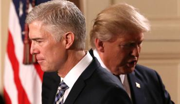 U.S. President Donald Trump steps back as Neil Gorsuch (L) approaches the podium to speak after being nominated to be an associate justice of the U.S. Supreme Court at the White House in Washington, D.C., U.S., January 31, 2017. REUTERS/Carlos Barria - RTX2Z34G