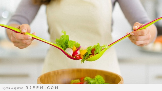 Closeup on housewife mixing vegetable salad