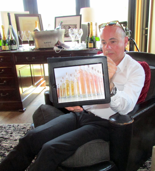 Krug cellar master Eric Lebel, with an iPad photo of some of different wines considered for a Grand Cuvee