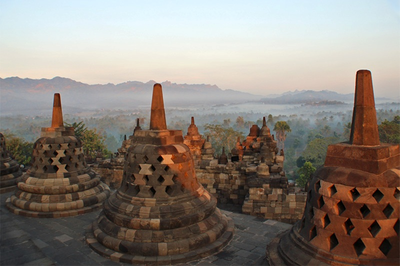 Sunrise from Borobudur Temple overlooking the Kedu Plain