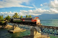 Train passing by Lake Singkarak, near Padang, West Sumatra