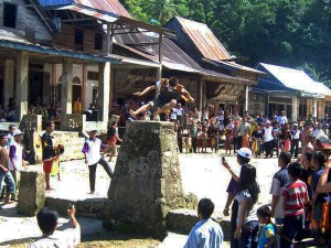"""The ancient practise of """"lompat batu"""" stone jumping in action"""